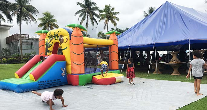 The bouncy castle at Suva Bowling Club is part of the Sunday market day. It allows parents to sell their goods while the children frolick in a safe space. Photo: Frederica Elbourne.