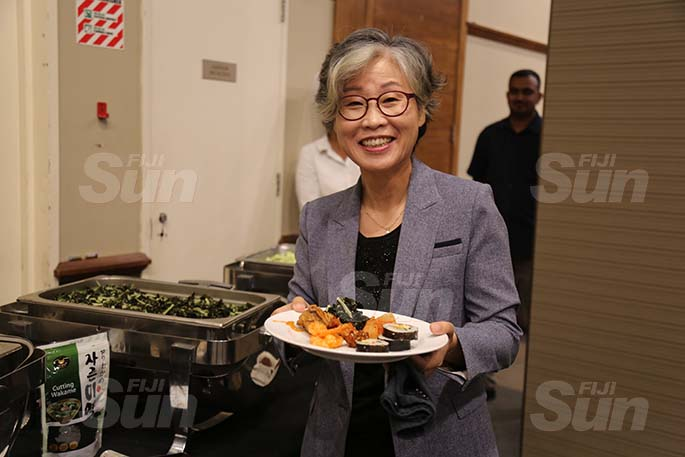 Korean Ambassador to Fiji Shin-hee CHO dishes a plate of Korean dishes at the Grand Pacific Hotel in Suva on August 26, 2020.