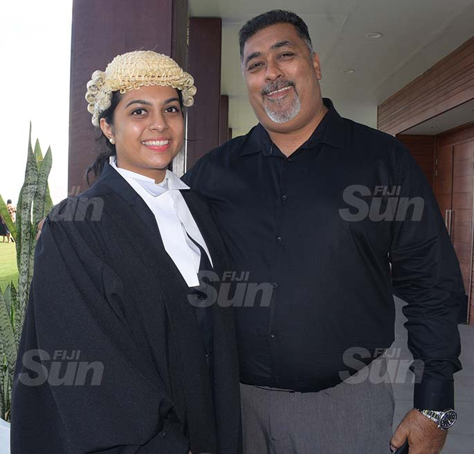 Faiyaz Saheb congratulate his daughter, Shahista Saheb following her admission to the Bar by Acting Chief Justice Kamal Kumar at GPH on August 7, 2020. Photo: Ronald Kumar.