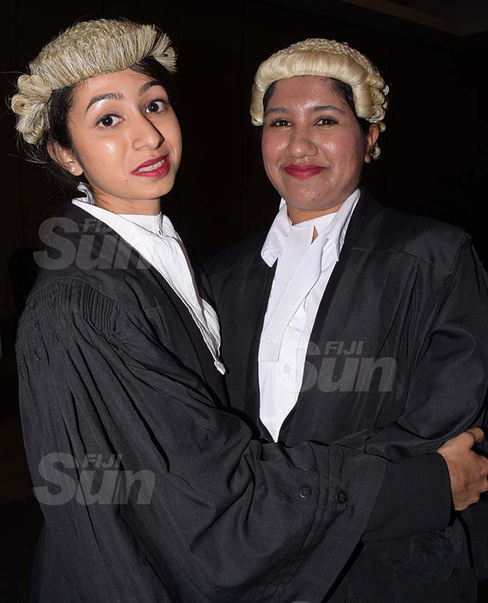 Friends Zeba Ali (left) and Shinal Devi congratulate each other following their admission to the Bar by Acting Chief Justice Kamal Kumar at GPH on August 7, 2020. Photo: Ronald Kumar.