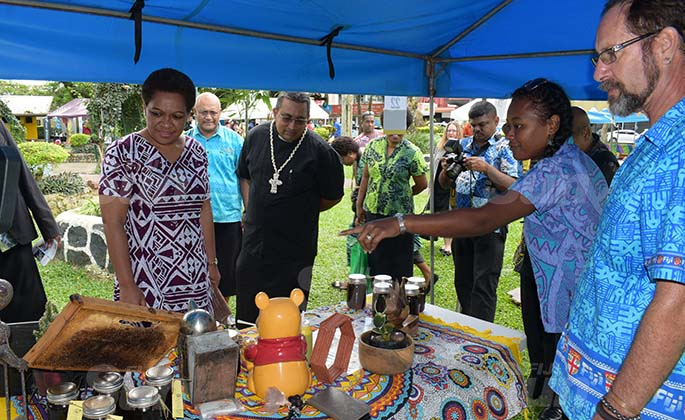 Suzie Hirst Tuilau and Mark Hirst (right) explain what they had on offer to Minister for Women Meresaini Vuniwaqa during Open Market Day at Ratu Sukuna Park on August 7, 2020. Photo: Ronald Kumar.
