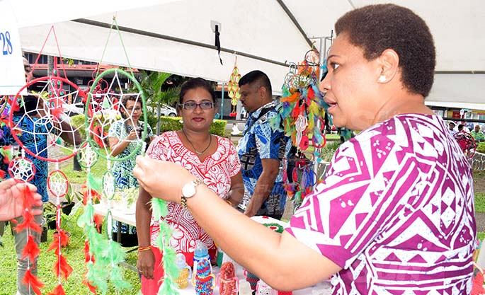 Amrita Nand 33 with some of her hand made products on sale with Womens Minister Meresaini Vuniwaqa during Open Market Day at Ratu Sukuna Park on August 7, 2020. Photo: Ronald Kumar.