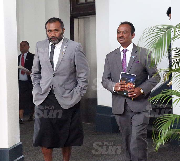 Minister for Health and Medical Services, Dr Ifereimi Waqainabete and Assistant Minister for Rural and Maritime Development and Disaster Management, Vijay Nath outside of Parliament on August 31, 2020. Photo: Kelera Sovasiga