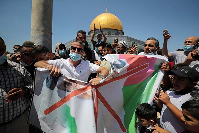 A group of Palestinians protest against the United Arab Emirates in East Jerusalem's Old City on August 14, 2020.