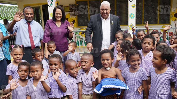From left- Minister for Health Dr. Iferemi Waqainabete, Minister for Education Rosy Akbar and Prime Miniter Voreqe Bainimarama with Suvavou Kindergarten students after the opening on August 12, 2020. Photo: Ronald Kumar.
