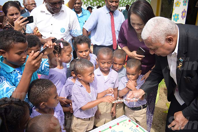 Minister for Education Rosy Akbar and Prime Minister Voreqe Bainimarama shares cake with Suvavou Kindergarten students after the opening on August 12, 2020. Photo: Ronald Kumar.