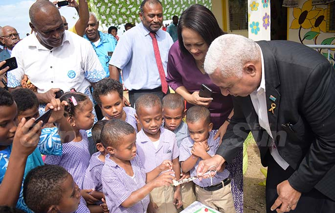 Minister for Health Dr. Iferemi Waqainabete, Minister for Education Rosy Akbar and Prime Minister Voreqe Bainimarama shares cake with Suvavou Kindergarten students after the opening on August 12, 2020. Photo: Ronald Kumar.