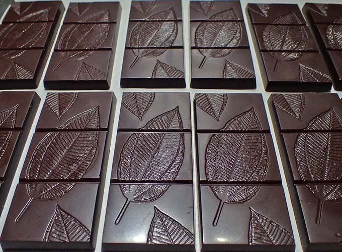Creative chocolate moulding – using forest leaves to produce elegant 'chocolate leaves'.