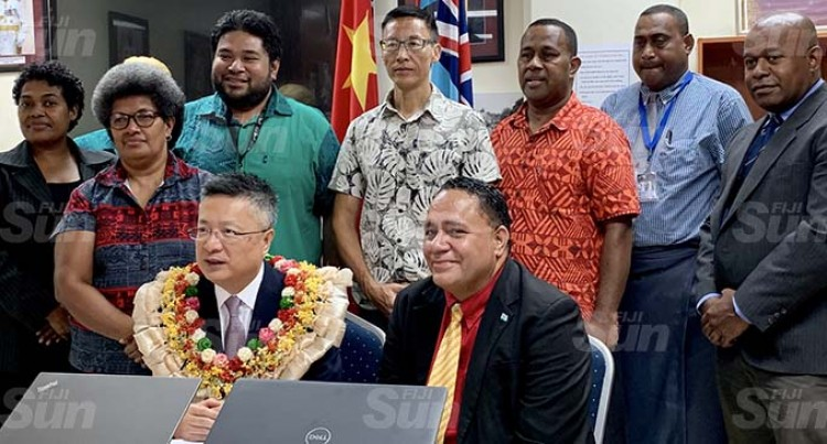 Chinese Embassy Donates $10K And Laptops To Archives