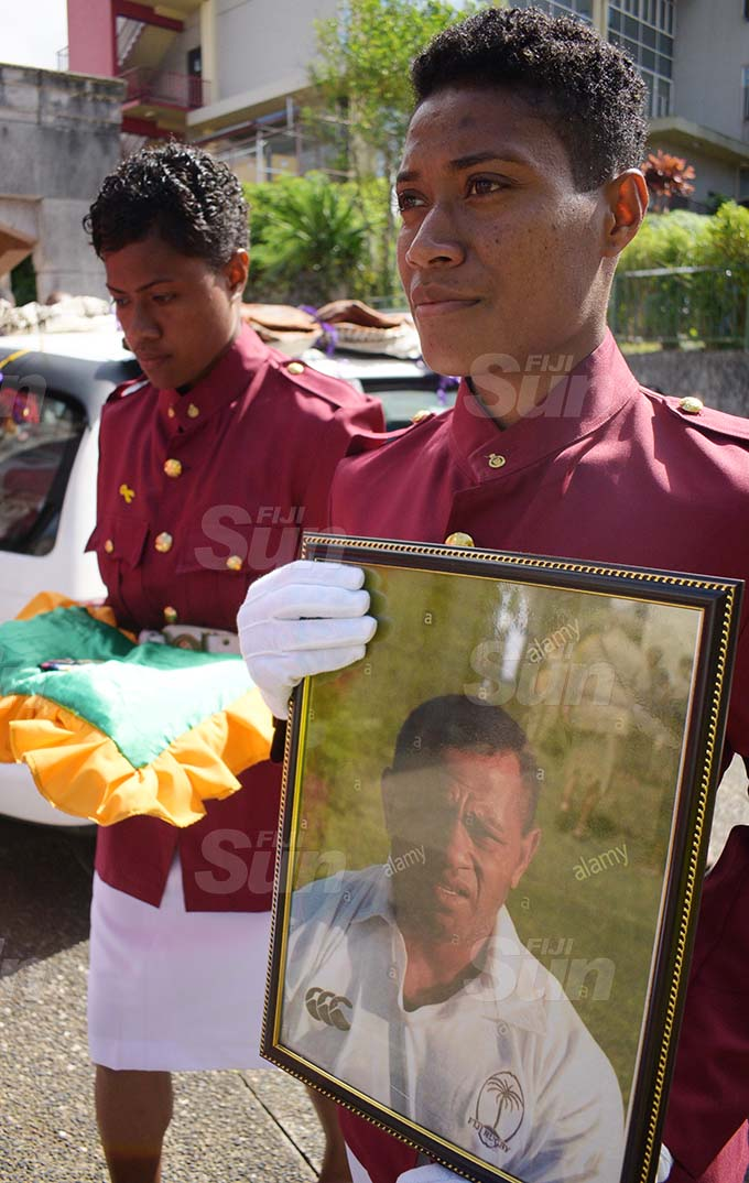 Fiji Correction servicers, COC Serewaia Meli with photo of late Principal Corrections officer and former National 7's palyer during the funeral service at Centenary Methodist Church on September 16, 2020. Photo: Ronald Kumar.