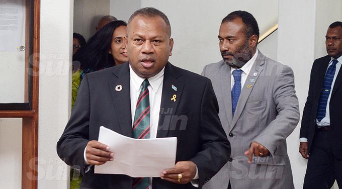 Minister for Defense Inia Seruiratu (left)  and Minister for Health Inia Seruiratu outside Parliament 2, 2020. Photo: Ronald Kumar.