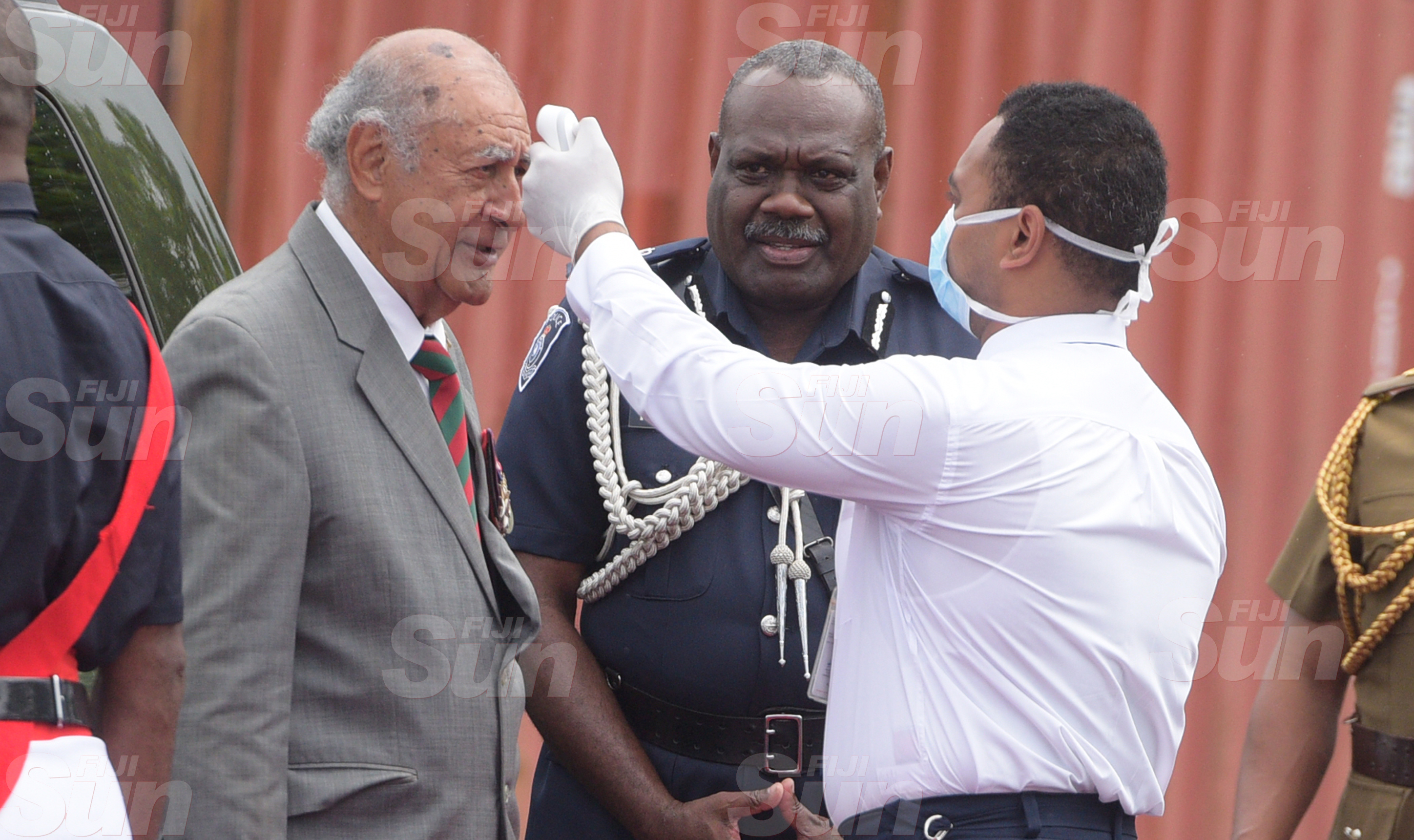 Speaker of Parliament Ratu Epeli Nailatikau gets his temperature checked as Police Commissioner Rusiate Tudravu looks on during Police Remembrance Day ceremony at Police Special Response Unit on September 29, 2020. Photo: Ronald Kumar