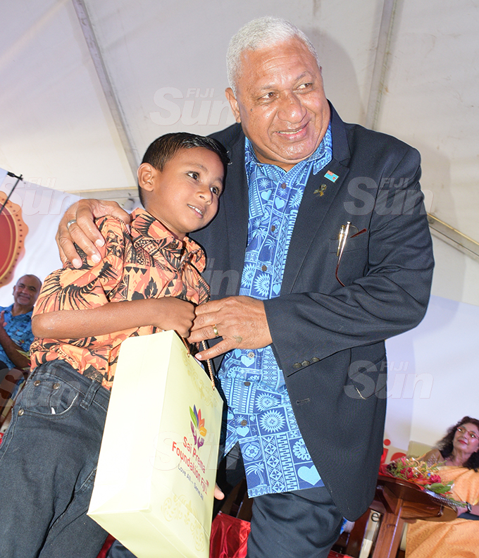 Prime Minister Voreqe Bainimarama with  5 year-old Darsh Prasad during Sai Sanjeevani medical centre 4th year anniversary on September 19, 2020. Photo: Ronald Kumar.