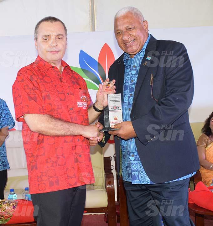Prime Minister Voreqe Bainimarama awards Ambassador Jean-Francois Fitou as Heart Ambassador during Sai Sanjeevani medical centre 4th year anniversary on September 19, 2020. Photo: Ronald Kumar.