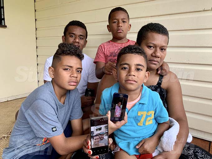 Wife of accident victim Olivia Bulutani with her sons holding the picture of their late father and grandmother. (back from left) Asaeli Bulutani, 17, Ledua Bulutani Junior, 8, (front from left) Robert Bulutani, 12, and Jone Bulutani, 5, at their home in Namadi, Suva on September 21, 2020. Photo: Inoke Rabonu