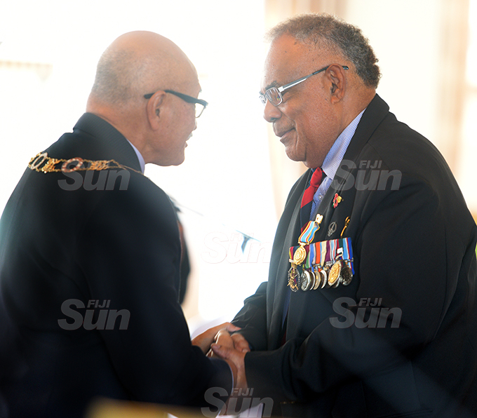 Lt. Col. (Ret'd) Sakiusa Raivoce received the 50th anniversary of Independence commemorative medal from President Jioji Konrote during special investiture ceremony at State House on October 7, 2020. Photo: Ronald Kumar.