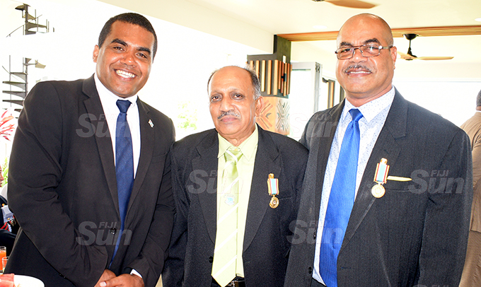 Assistant Minister for Youth and Sports Alipate Naqata (left) with medal recipient, Bishwa Sidal and Matetino Nemani after receiving 50th anniversary of Independence commemorative medal during special investiture ceremony at State House on October 7, 2020. Photo: Ronald Kumar.