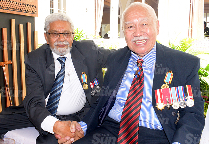 Sayed Abdul-Khaiyum (left) and Sir James Ah Koy after receiving 50th anniversary of Independence commemorative medal during special investiture ceremony at State House on October 7, 2020. Photo: Ronald Kumar.