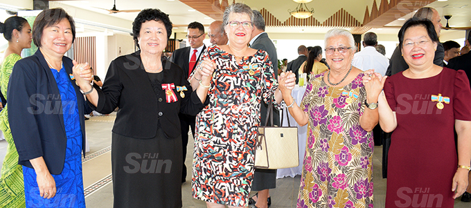 Ex-St Joseph students, (from left) Lorraine Mar, Jenny Seeto, Elizabeth Fong, Aileen Burness and Lorraine Seeto after receiving their 50th anniversary of Independence commemorative medal during special investiture ceremony at State House on October 7, 2020. Photo: Ronald Kumar.