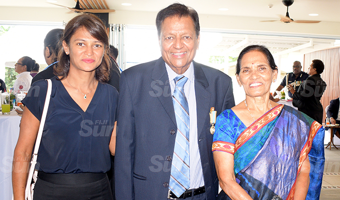 Bachubhai Patel (middle) with daughter Nikita Patel and wife, Sunita Ben after receiving 50th anniversary of Independence commemorative medal during special investiture ceremony at State House on October 7, 2020. Photo: Ronald Kumar.