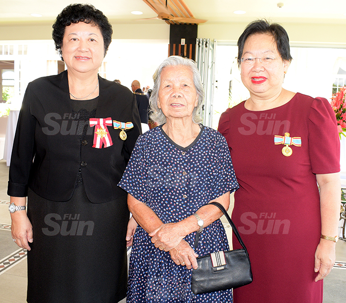 Jenny Seeto (left) and Lorraine Seeto (right) with their 89 year-old mother, Seeto Hui after receiving their 50th anniversary of Independence commemorative medal during special investiture ceremony at State House on October 7, 2020. Photo: Ronald Kumar.