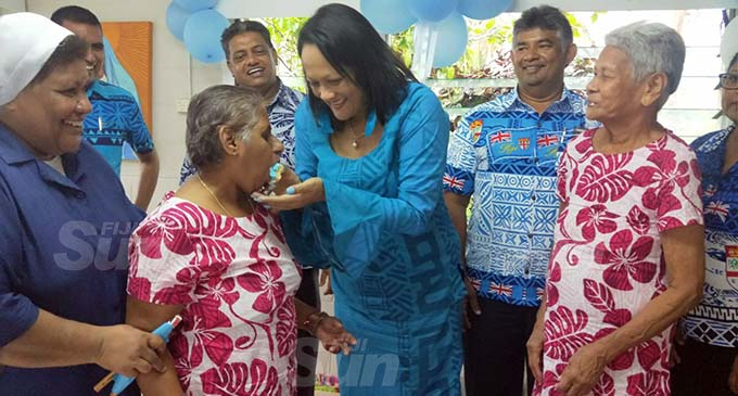 Minister Rosy Akbar with senior citizens of Father Law Home.