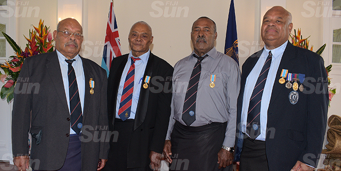 The four retired fire officers, (from left) Epeli Matata, Luke Qase, Paula Radrodro and Kaliova Turaga after receiving 50th anniversary of Independence commemorative medal during special investiture ceremony by President Jioji Konrote at State House on October 6, 2020. Photo: Ronald Kumar.