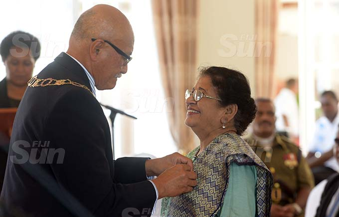 Noor Jahan received 50th anniversary of Independence commemorative medal during special investiture ceremony from President Jioji Konrote at State House on October 6, 2020. Photo: Ronald Kumar.