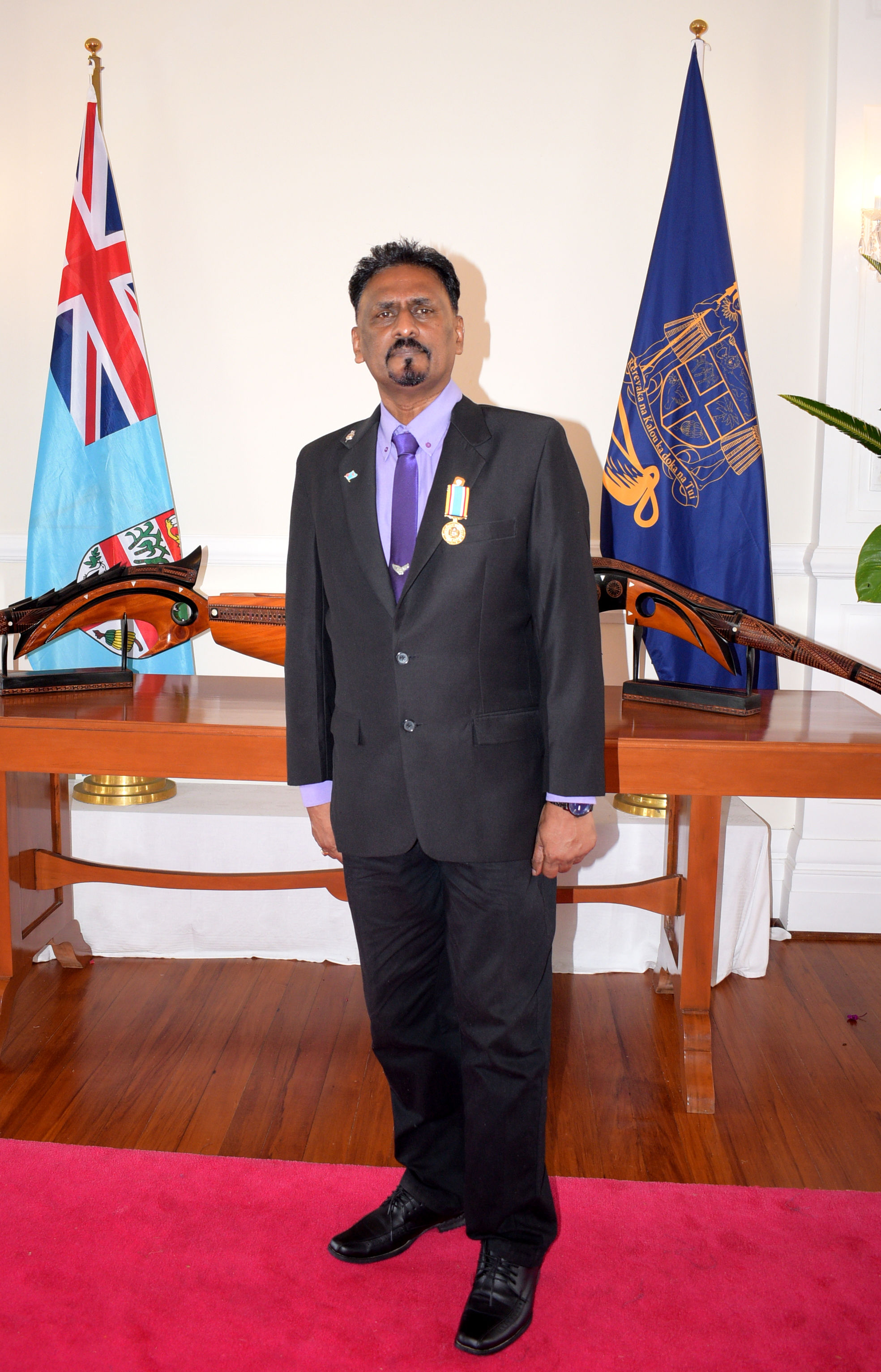 Former School teacher, Subhash Chandra after receiving 50th anniversary of Independence commemorative medal during special investiture ceremony at State House on October 8, 2020. Photo: Ronald Kumar.