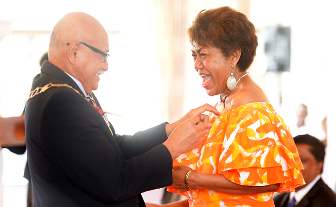 President Jioji Konrote awards 50th anniversary of Independence commemorative medal to Laisa Vulakoro at State House on October 27, 2020. Photo: Ronald Kumar.