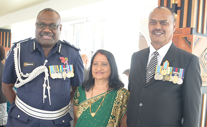 Retired Acting Police Commissioner Ravi Narayan (right) with wife Bansanti Narayan and Acting Police Commissioner Rusiate Tudravu after receiving 50th anniversary of Independence commemorative medal from President Jioji Konrote at State House on October 27, 2020. Photo: Ronald Kumar.