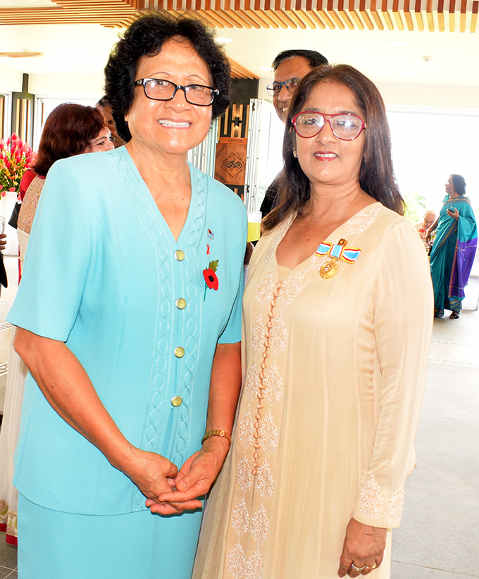 Firstlady Sarote Konrote (left) Shaenaz Voss Fiji Link Executive General Manager Corporate Communication after receiving 50th anniversary of Independence commemorative medal from President Jioji Konrote at State House on October 27, 2020. Photo: Ronald Kumar.