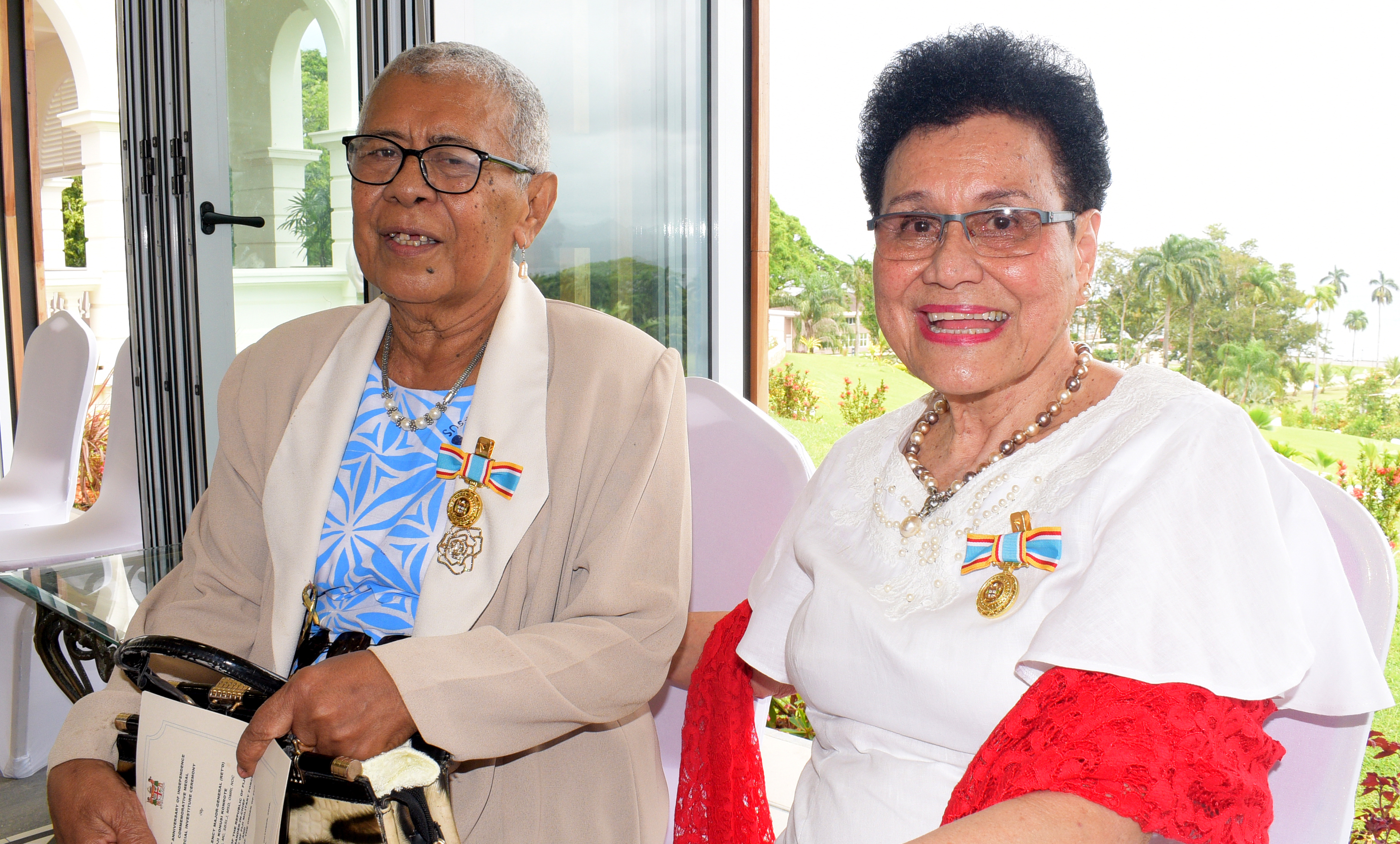 Susana Evening (left) and Dr. Mere Samisoni after receiving 50th anniversary of Independence commemorative medal from President Jioji Konrote during special investiture ceremony at State House on October 13, 2020. Photo: Ronald Kumar.