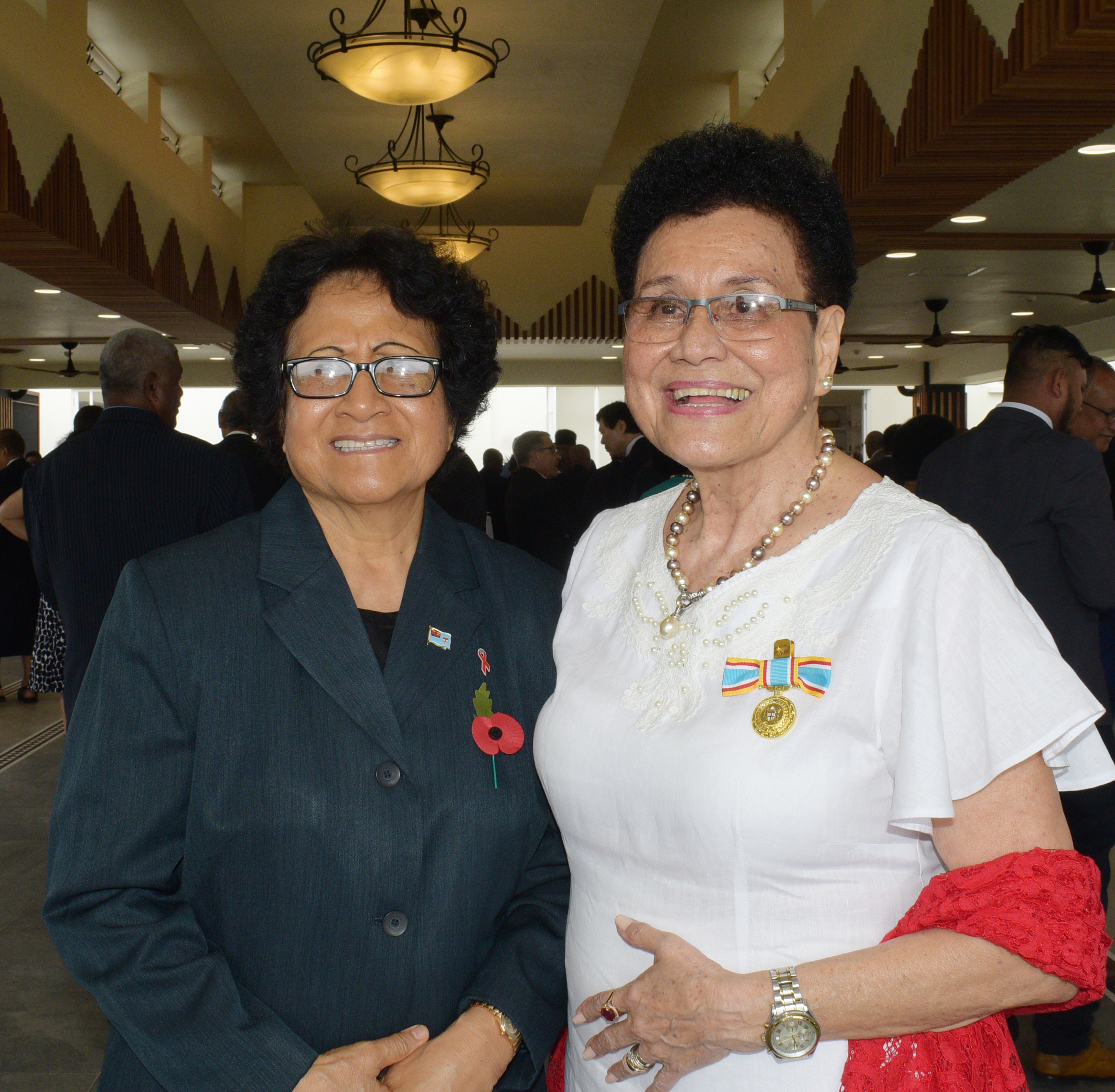 First Lady, Sarote Konrote (left) and Dr. Mere Samisoni  following the 50th anniversary of Independence commemorative medal investiture ceremony at State House on October 13, 2020. Photo: Ronald Kumar.