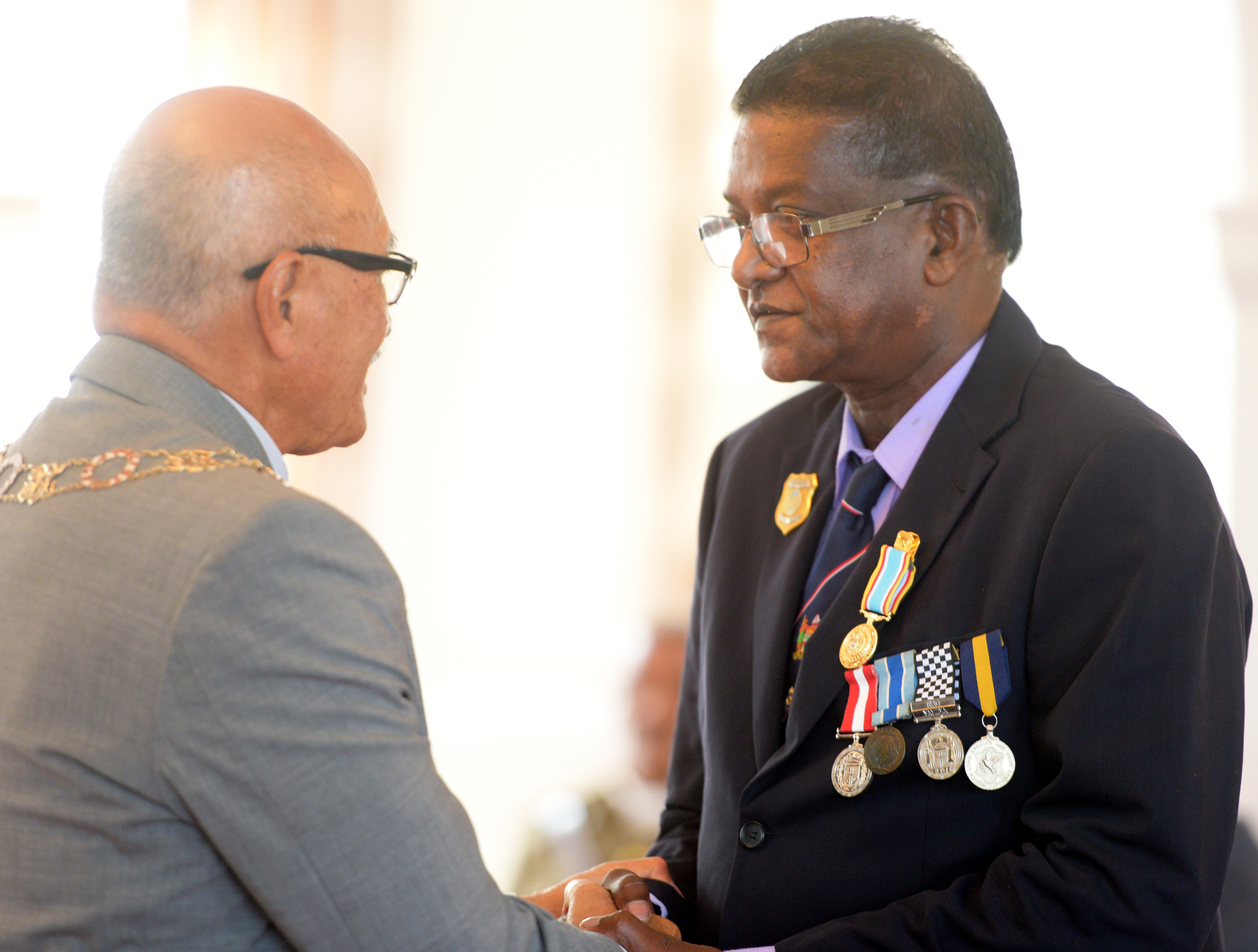 President Jioji Konrote awards Raymond Mukesh Mani with 50th anniversary of Independence commemorative medal during special investiture ceremony at State House on October 13, 2020. Photo: Ronald Kumar.