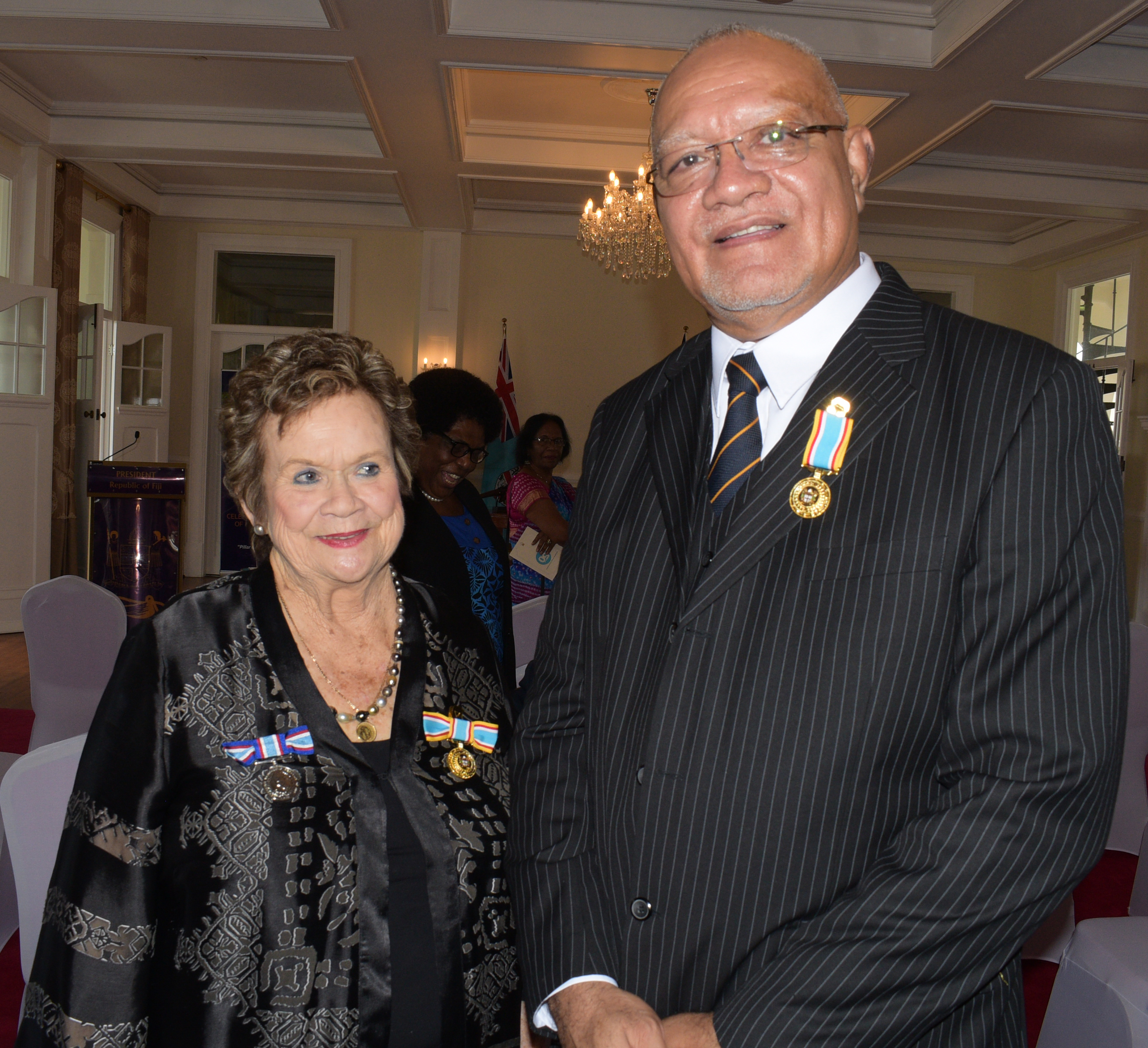 Gaetane Austin (left) and Dr. Joji Malani after receiving 50th anniversary of Independence commemorative medal from President Jioji Konrote during special investiture ceremony at State House on October 13, 2020. Photo: Ronald Kumar.