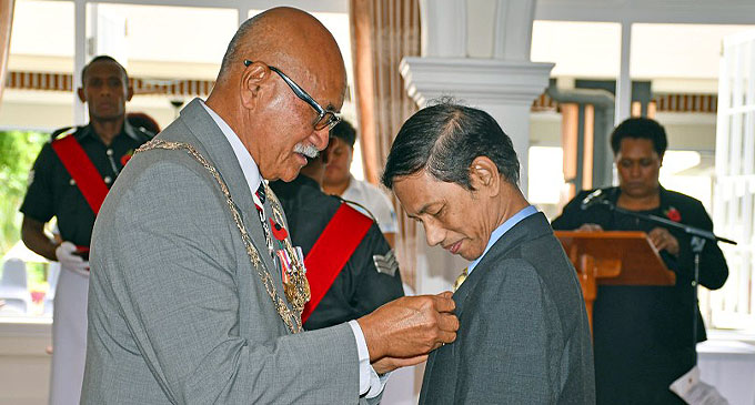 The President, Major-General (Ret'd) Jioji Konusi Konrote awarding Fiji's 50th Anniversary of Independence Commemorative Medal to Dr Virgilio De Asa Snr during the Investiture Ceremony at the State House, Suva on October 26, 2020. Photo: Fijian Government Facebook