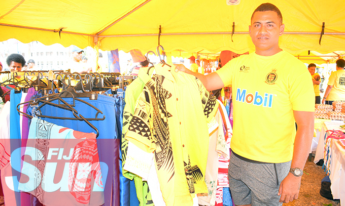 Fiji Corrections Service officer, COB Jone Ledua with some of their products on sale during their annual yellow ribbon walk at Albert park on October 31, 2020. Photo: Ronald Kumar.