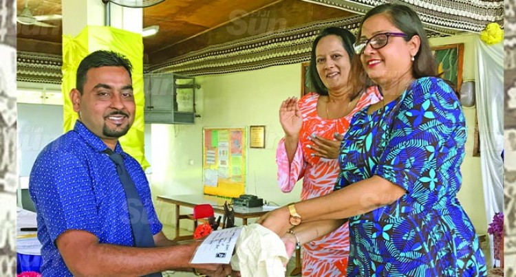 Minister Akbar Gives LaptopsT Fiji50-Seconds Video Winners