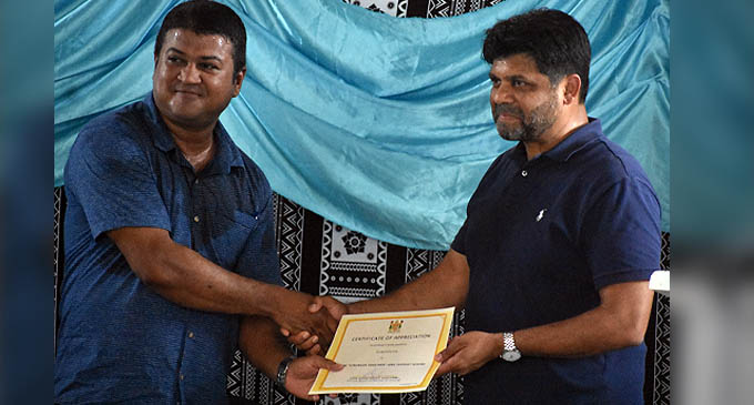 The Attorney-General and Minister for Economy Aiyaz Sayed-Khaiyum (right) handing over a certificate to Fiji Rice Limited Manager Ashrit Pratap for employing workers at the mill during this pandemic.