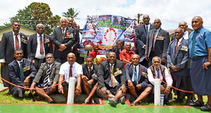 Prime Minister Voreqe Bainimarama with 3FIR veterans at the memorial of the November 2, 2000 failed attempted mutiny at Queen Elizabeth Barracks in Nabua on November 2, 2020. Photo: Office of the Prime Minister