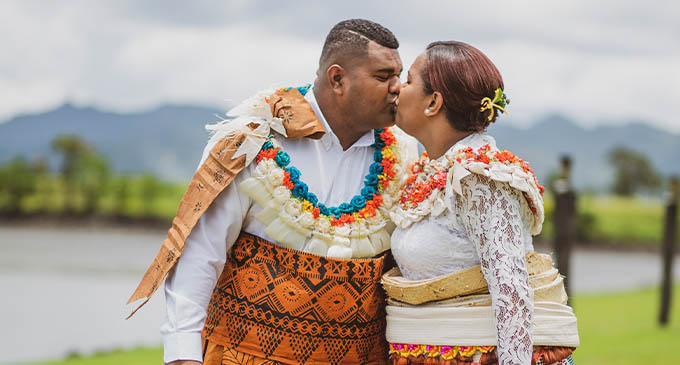 Sealed with a kiss! ... newly-weds Osea Korovou and Ma'ata Matavewa. Photos: Leon Lord