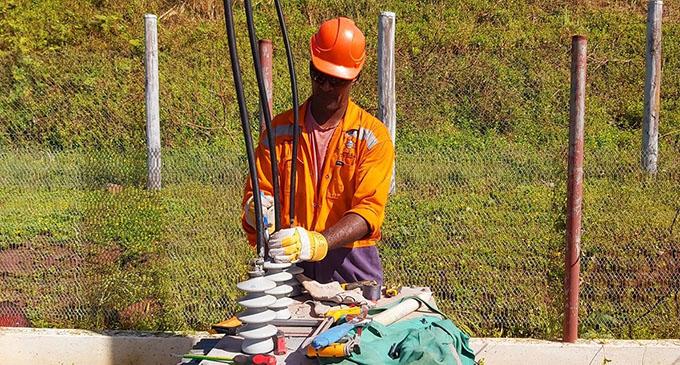 Working to restore power .... an EFL worker at Nabouwalu. Photo: Joe Raketekete