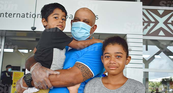 Ronald Rohit Kumar with his children at Nadi International Airport on December 9, 2020. Photo: Mereleki Nai