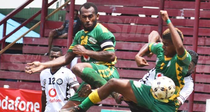Vinz Works Suva captain Ravinesh Karan Singh is being sandwiched by Nadi captain Sakaraia Naisua (left) and Mosese Nauci (9) during the Vodafone Fiji FACT final at Subrail Park, Labasa on December 6, 2020. Suva won 1-0. Photo: Renu Radika