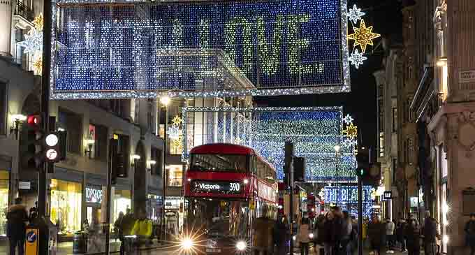Photo taken on Nov. 3, 2020 shows the Christmas lights illuminating the main shopping Oxford Street in London, Britain. (Xinhua/Han Yan)