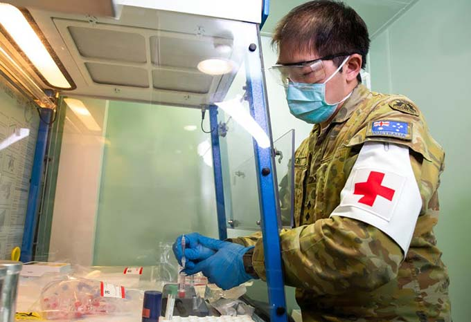 Australian Army officer, Lieutenant Intae Park, prepares COVID-19 samples for testing at the Medical Centre onboard HMAS Adelaide as part of the COVID-19 safety protocols for Operation Fiji Assist. Photo: Australian Defence Force