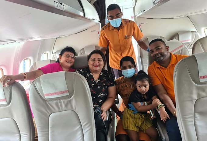 The Nand family of Lautoka with the Fiji Link cabin crew.