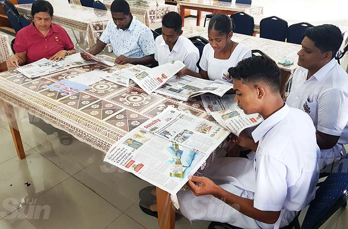 Tilak High School librarian Mrs P Singh, teacher N Ramlu with students Rahul, Berenadeta, Anush and Aryan all reading yesterday's Fiji Sun newspaper as part of the Fiji Sun's Newspapers in Education programme. Photo: Shonal Chand