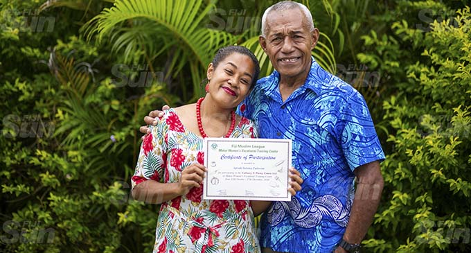 Apisaki Tuilovoni with her father Esakaia Tuilovoni after the Makoi Women's Vocational Training Centre graduation on January 13, 2021. Photo: Leon Lord
